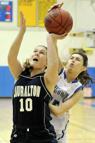 Newtown's Erin Kenning blocks the shot of Carly Fabbri, of Lauralton Hall, during their game at Newtown High School on Friday, Jan. 11, 2013. Lauralton Hall won, 50-44. Photo: Jason Rearick / The News-Times