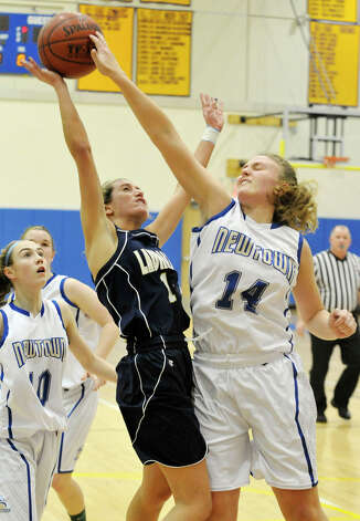 Newtown's Maddy Good blocks the shot of Michelle DeSantis, of Lauralton Hall, during their game at Newtown High School on Friday, Jan. 11, 2013. Lauralton Hall won, 50-44. Photo: Jason Rearick / The News-Times