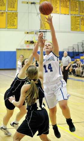 Newtown's Maddy Good shoots over Lauralton Hall's Michelle DeSantis during their game at Newtown High School on Friday, Jan. 11, 2013. Lauralton Hall won, 50-44. Photo: Jason Rearick / The News-Times