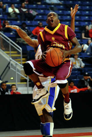 St. Joseph's #30 Raekwon Reid goes to the basket, during boys basketball action against Harding at the Webster Bank Arena in Bridgeport, Conn. on Thursday January 11, 2013. Photo: Christian Abraham / Connecticut Post