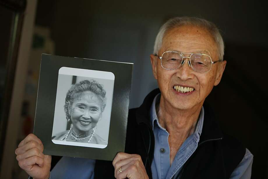Clarence Chan with his late wife's portrait: The couple created a $1 million endowment. Photo: Lea Suzuki, The Chronicle
