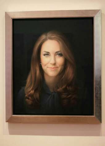 A newly-commissioned portrait of Kate, Duchess of Cambridge, by artist Paul Emsley hangs at the National Portrait Gallery in London, Friday, Jan. 11, 2013. (AP Photo/Sang Tan) Photo: Sang Tan / AP