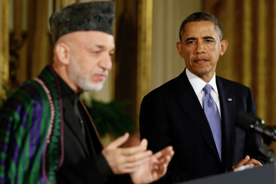 President Barack Obama listens as Afgan President Hamid Karzai speaks during their joint news conference in the East Room at the White House in Washington, Friday, Jan. 11, 2013. (AP Photo/Charles Dharapak) Photo: Charles Dharapak