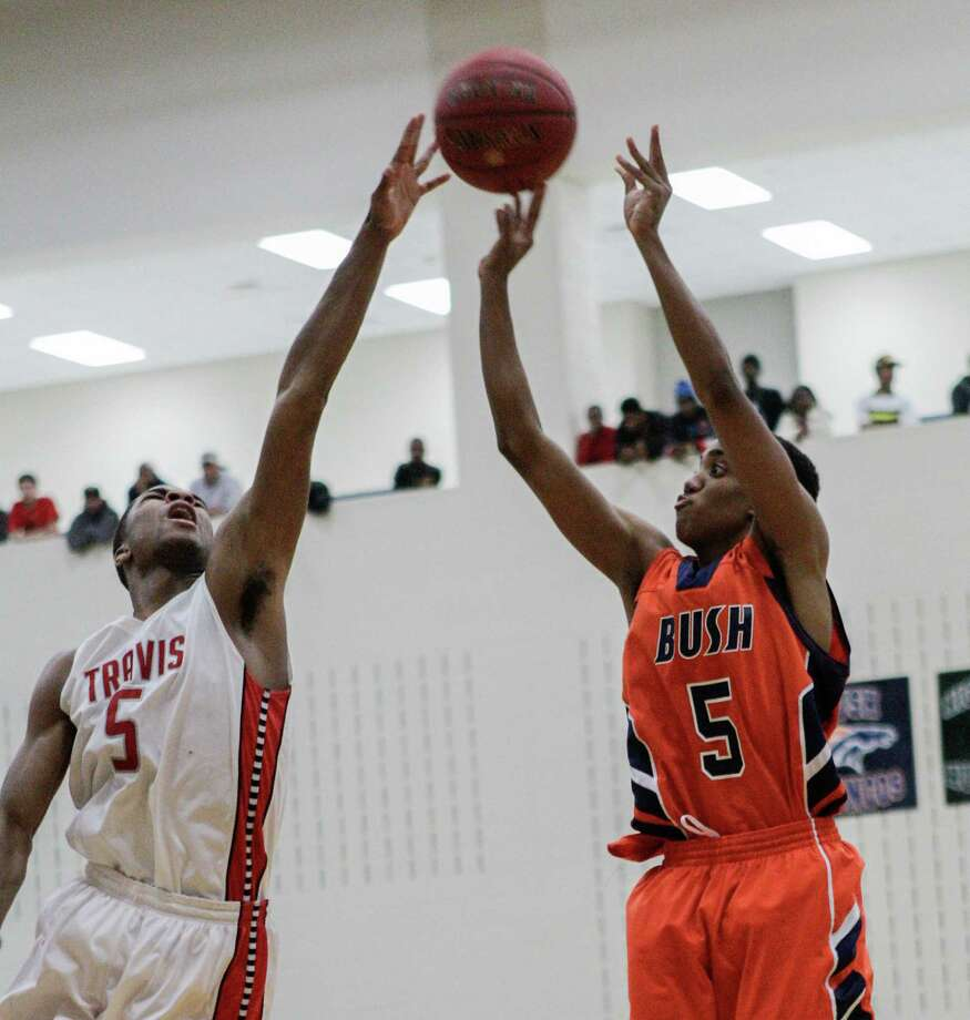 Bush's Shawndre Jones has his jumper blocked by Travis' Andrew Harrison during a high school basketball game between Travis and Bush at Hopson Fieldhouse, Friday, January 11, 2013. Bush defeated Travis 61-58 in overtime. Photo: Bob Levey, Houston Chronicle / ©2013 Bob Levey