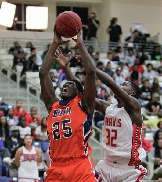 Bush's Brandon Jones fights for a rebound with Travis' Juwan Williams during a high school basketbal