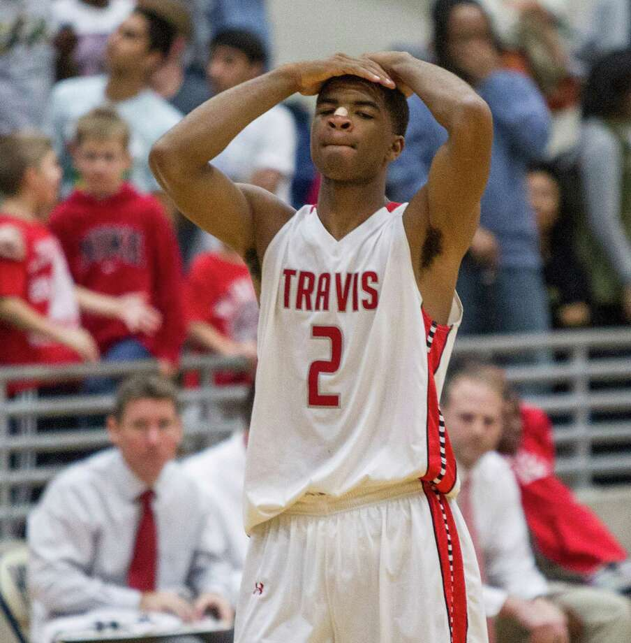 Travis' Aaron Harrison reacts in the overtime period during a high school basketball game between Travis and Bush at Hopson Fieldhouse, Friday, January 11, 2013. Bush defeated Travis 61-58 in overtime. Photo: Bob Levey, Houston Chronicle / ©2013 Bob Levey