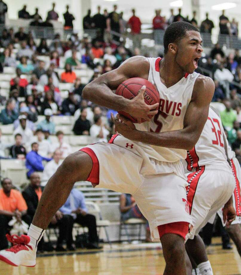 Travis' Andrew Harrison grabs a rebound in the overtime period during a high school basketball game between Travis and Bush at Hopson Fieldhouse, Friday, January 11, 2013. Bush defeated Travis 61-58 in overtime. Photo: Bob Levey, Houston Chronicle / ©2013 Bob Levey