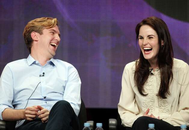 Actors Dan Stevens and Michelle Dockery share a big laugh, which is something their lovebird characters don't do often. They're pictured at a 'Downton Abbey' media event in 2011.  Photo: Frederick M. Brown, Getty Images / 2011 Getty Images
