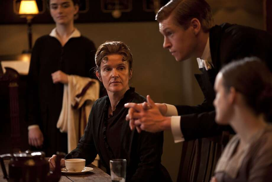 ... this, as O'Brien (center), the scheming lady's maid. There's something transforming about those forehead curls.