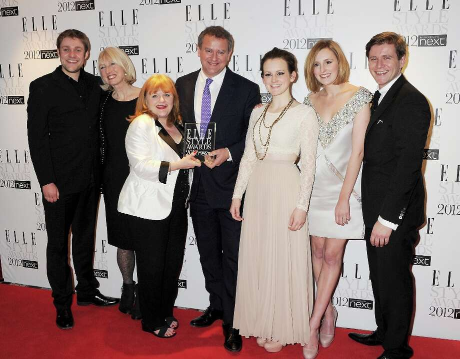The cast and crew of 'Downton Abbey' (L to R): Thomas Howes, (costume designer) Susannah Buxton, Lesley Nicol, Hugh Bonneville, Sophie McShera, Laura Carmichael and Allen Leech pose with the Elle Style 'Best TV' award in 2012.  Photo: Dave M. Benett, Getty Images / 2012 Dave M. Benett