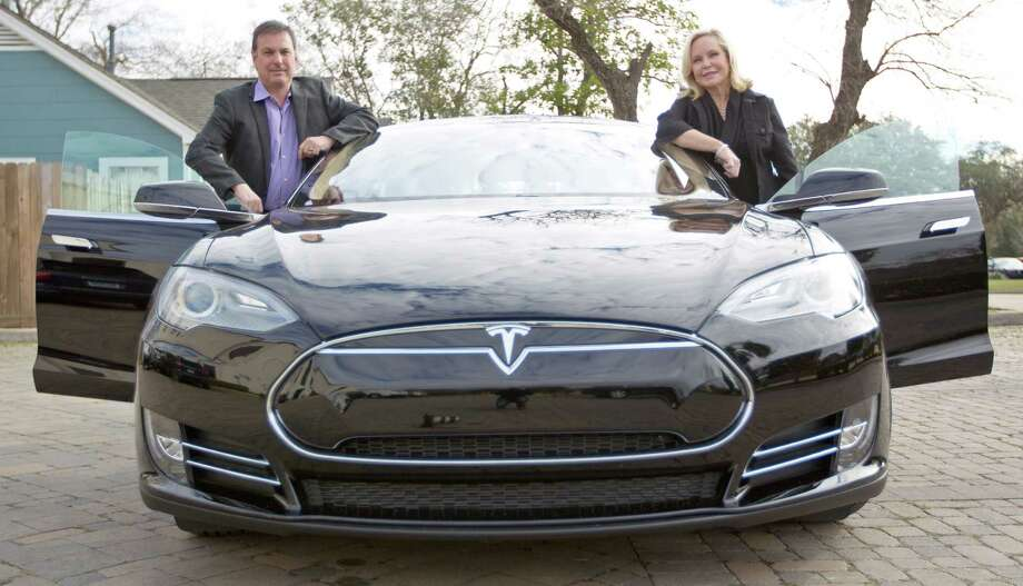 """Tom Hedge and Kathy Frazar are plenty enthusiastic about their newly arrived Tesla S. """"It's car 2.0. If Apple made a car, this would be it,"""" he says. Photo: Karen Warren, Staff / © 2012 Houston Chronicle"""