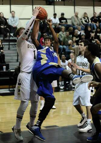 Ozen player Wayne Wyngard, #34, is fouled by Nederland player Colton Weisbrod, #1, during the Nederland High School basketball game against the Ozen High School on Friday, January 11, 2013, at Nederland High School. Ozen won over Nederland 66- 59. Photo taken: Randy Edwards/The Enterprise Photo: Randy Edwards