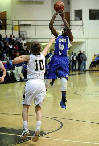 Ozen player Damasters Sam, #15, puts it up for two during the Nederland High School basketball game against the Ozen High School on Friday, January 11, 2013, at Nederland High School. Ozen won over Nederland 66- 59. Photo taken: Randy Edwards/The Enterprise
