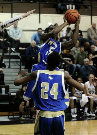 Ozen player Damasters Sam, #15, puts it up for two during the Nederland High School basketball game against the Ozen High School on Friday, January 11, 2013, at Nederland High School. Ozen won over Nederland 66- 59. Photo taken: Randy Edwards/The Enterprise Photo: Randy Edwards