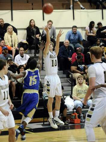 Nederland player Zach English, #10, puts it up for three during the Nederland High School basketball game against the Ozen High School on Friday, January 11, 2013, at Nederland High School. Ozen won over Nederland 66- 59. Photo taken: Randy Edwards/The Enterprise Photo: Randy Edwards