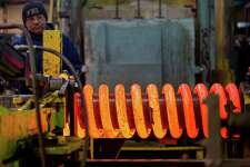 1/7/2013: Antonio Henriquez, Moris Contreras and Jose Zelaya, perform the hot coil process at Suhm Spring Works in Houston Texas. The three work together by removing 1.968 inch carbon steel from a 1700 degree furnace; then wrap the coil then move the coil to a 1200 degree oil quench. The coil is then moved from the oil quench to a resting plate where it cools down to 240 degrees. The springs are used for oil wells.