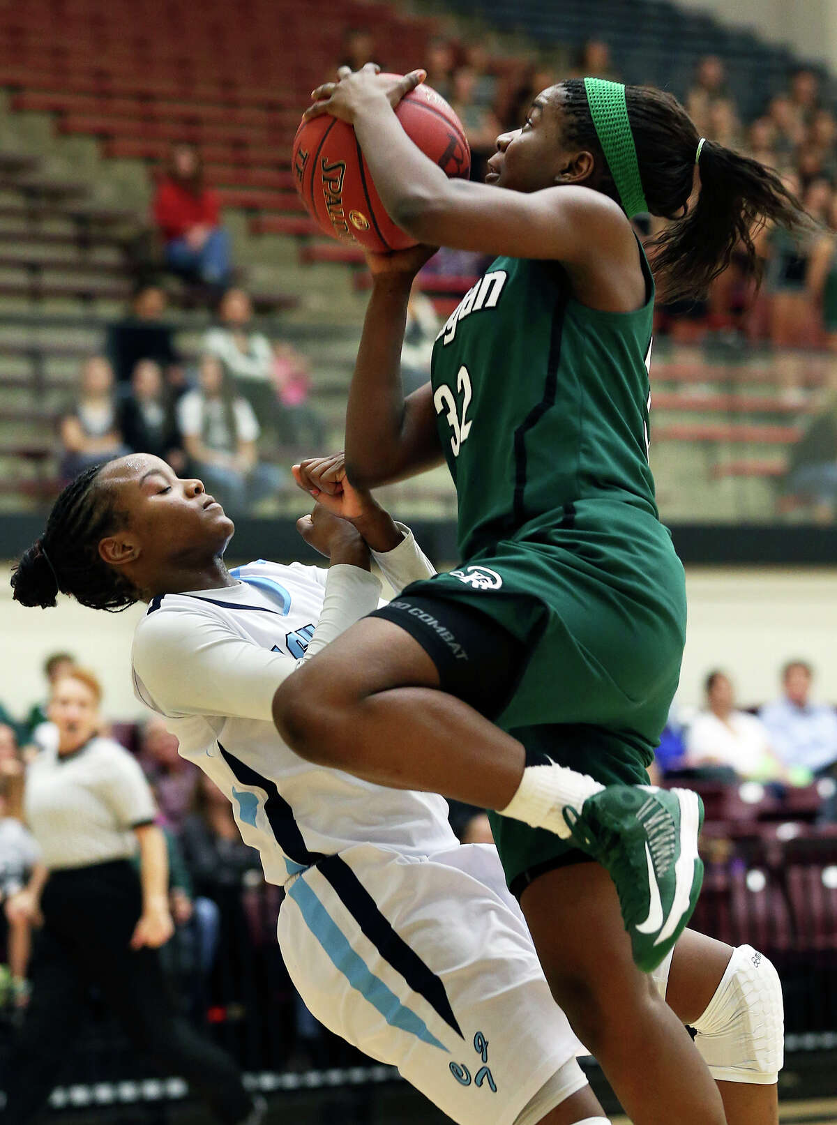 Reagan's Moriah Mack moves to the bucket on Erica Sanders as Reagan plays Johnson in girls basketball at Littleton Gym on January 11, 2013.