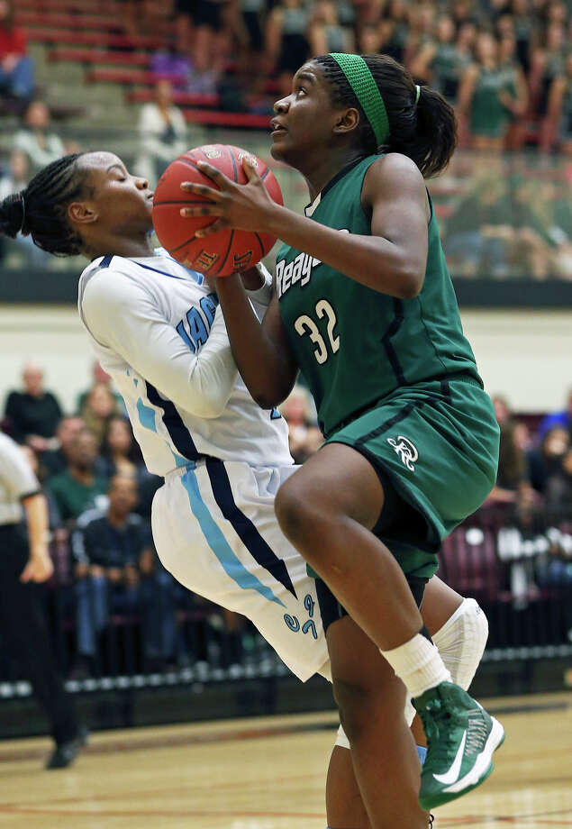 Reagan's  Moriah Mack moves to the bucket on Erica Sanders as Reagan plays Johnson in girls basketball at Littleton Gym on January 11, 2013. Photo: Tom Reel, Express-News / ©2012 San Antono Express-News
