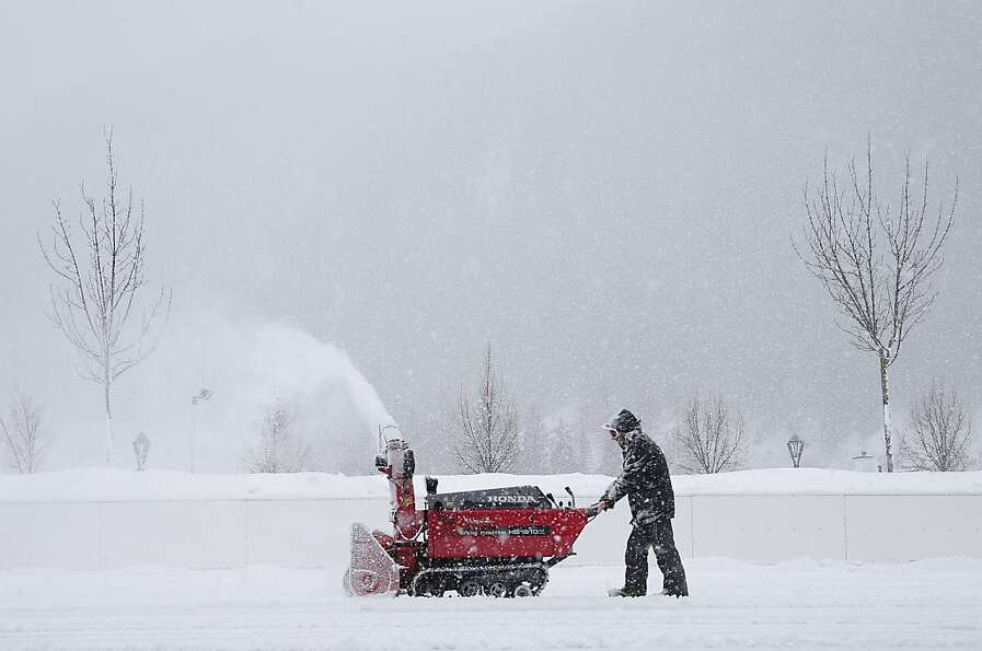 A man drives through the snow with a snow crawler in Sankt Anton am Arlberg, Austria on January 11,