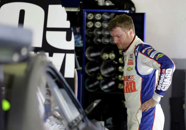Dale Earnhardt Jr. stands by his car in his garage after he started a wreck involving a group of cars during NASCAR auto race testing at Daytona International Speedway, Friday, Jan. 11, 2013, in Daytona Beach, Fla. (AP Photo/John Raoux) Photo: John Raoux