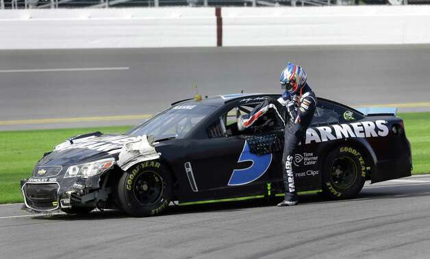 Kasey Kahne climbs out of his car on pit road after he was involved in a wreck during NASCAR auto race testing at Daytona International Speedway, Friday, Jan. 11, 2013, in Daytona Beach, Fla. (AP Photo/John Raoux) Photo: John Raoux
