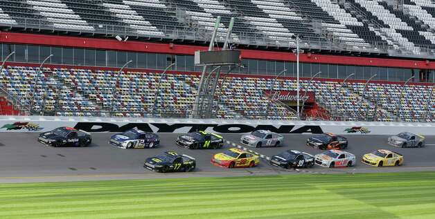 A pack of cars drives past the start/finish line moments before a wreck on the backstretch during NASCAR auto race testing at Daytona International Speedway, Friday, Jan. 11, 2013, in Daytona Beach, Fla. (AP Photo/John Raoux) Photo: John Raoux