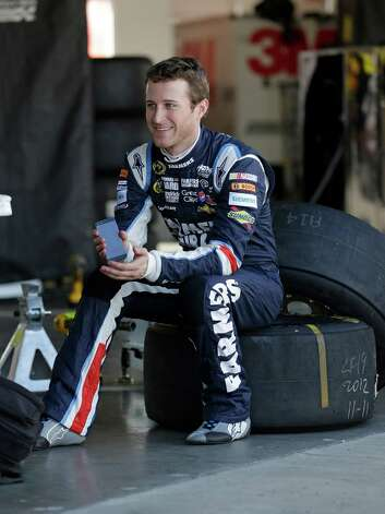 Driver Kasey Kahne talks with crew members in his garage during NASCAR auto race testing at Daytona International Speedway, Friday, Jan. 11, 2013, in Daytona Beach, Fla. (AP Photo/John Raoux) Photo: John Raoux