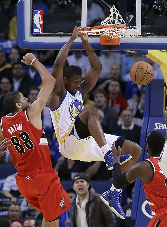 Golden State Warriors' Harrison Barnes (40) scores next to Portland Trail Blazers' Nicolas Batum (88) during the first half of an NBA basketball game Friday, Jan. 11, 2013, in Oakland, Calif. (AP Photo/Ben Margot) Photo: Ben Margot, Associated Press