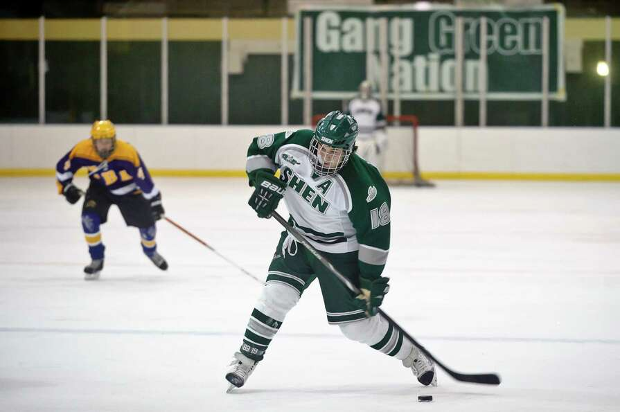 Shenendehowa Hockey player #4, Danny Stalica, lines up for a shot on the goal Friday night, Jan. 11,