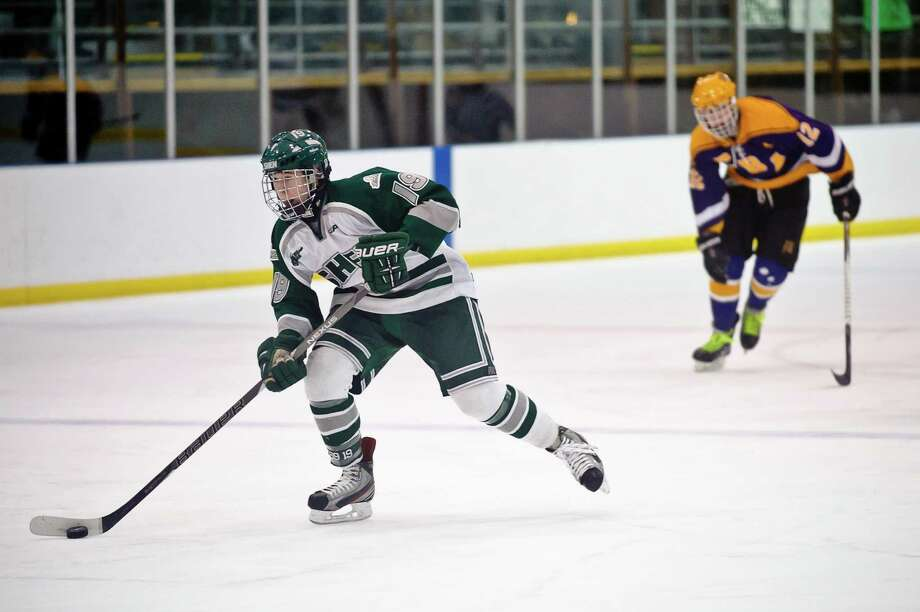 Shenendehowa hockey player #19, Peter Russo, moves past CBA Hockey player #12, Zach Swanteck with ease  Friday night, Jan. 11, 2013, at  Clifton Park Arena in Clifton Park, N.Y. during their hockey game. (Eric Jenks /Special to the Times Union) Photo: Eric Jenks