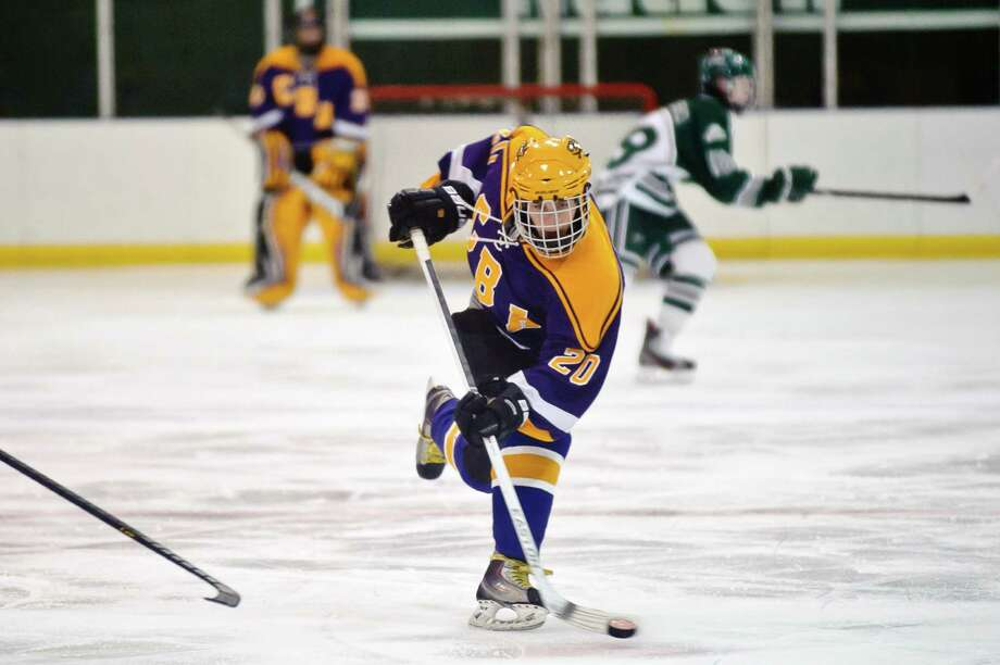 CBA hockey player #20, Sean Glennon, slams the puck towards the goal Friday night, Jan. 11, 2013, at  Clifton Park Arena in Clifton Park, N.Y. during the hockey game against Shenendehowa. (Eric Jenks /Special to the Times Union) Photo: Eric Jenks