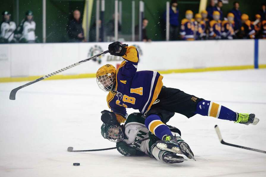 Shenendehowa hockey player #2, Ryan Mortka crashes to the ground with CBA player #12, Zach Swanteck,