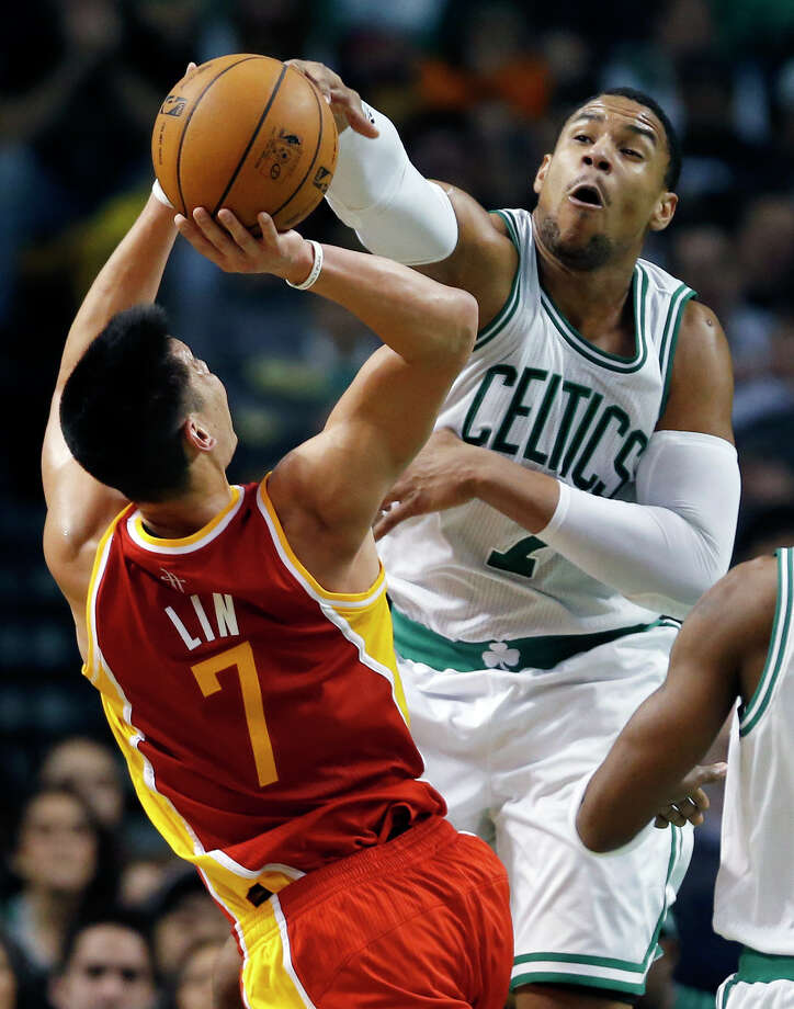 Boston Celtics' Jared Sullinger (7) blocks a shot by Houston Rockets' Jeremy Lin (7) in the third quarter of an NBA basketball game in Boston, Friday, Jan. 11, 2013. The Celtics won 103-91. (AP Photo/Michael Dwyer) Photo: Michael Dwyer