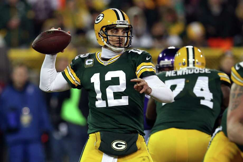 GREEN BAY, WI - JANUARY 05:  Quarterback Aaron Rodgers #12 of the Green Bay Packers throws the ball in the third quarter against the Minnesota Vikings during the NFC Wild Card Playoff game at Lambeau Field on January 5, 2013 in Green Bay, Wisconsin.  (Photo by Jonathan Daniel/Getty Images) Photo: Jonathan Daniel / 2013 Getty Images