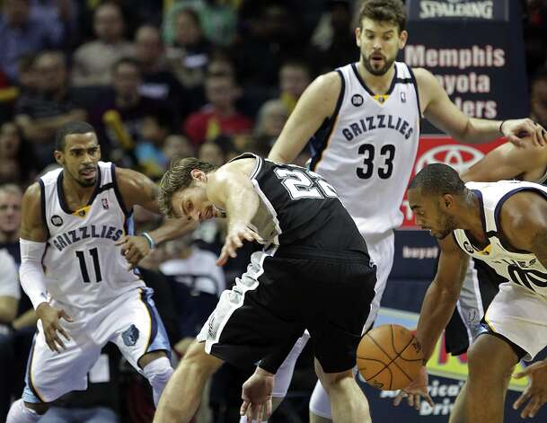 Spurs center Tiago Splitter (22) tries to recover a loose ball against Grizzlies players Mike Conley (11), Marc Gasol (33) and Darrell Arthur (00) in the second half on Friday, Jan. 11, 2013, in Memphis, Tenn. Memphis won in overtime 101-98. Photo: Lance Murphey, Associated Press / FR78211 AP