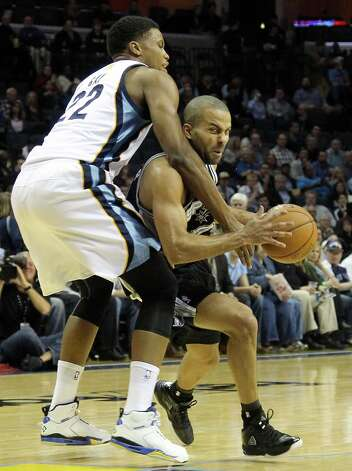 Grizzlies forward Rudy Gay (22) fouls Spurs guard Tony Parker in the first half  on Friday, Jan. 11, 2013, in Memphis, Tenn. Photo: Lance Murphey, Associated Press / FR78211 AP