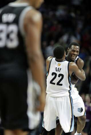 Grizzlies forward Rudy Gay (22) hugs teammate Tony Allen after stopping a shot by the Spurs in overtime on Friday, Jan. 11, 2013, in Memphis, Tenn. Memphis won in overtime 101-98. Photo: Lance Murphey, Associated Press / FR78211 AP