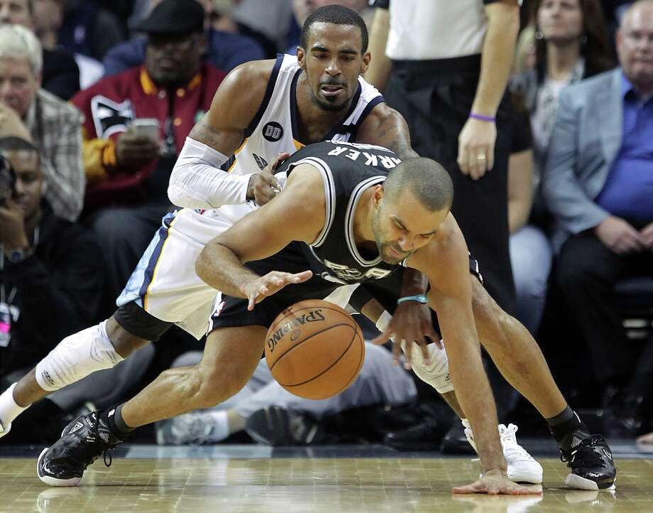 Grizzlies guard Mike Conley (top) tries to steal the ball from Spurs guard Tony Parker in the second half on Friday, Jan. 11, 2013, in Memphis, Tenn. Memphis won in overtime 101-98. Photo: Lance Murphey, Associated Press / FR78211 AP
