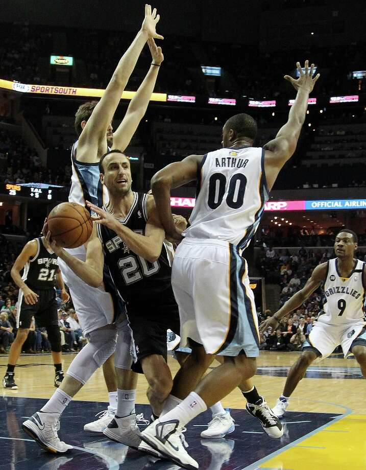 Spurs guard Manu Ginobili (20) drives between the Grizzlies' Marc Gasol (left),  Darrell Arthur (00) and Tony Allen (9) in the first half on Friday, Jan. 11, 2013, in Memphis, Tenn. Photo: Lance Murphey, Associated Press / FR78211 AP