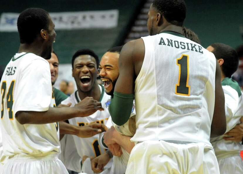 Siena's Rakeem Brookins, center, celebrates his last-second 3-point basket to win 57-54 over Canisiu