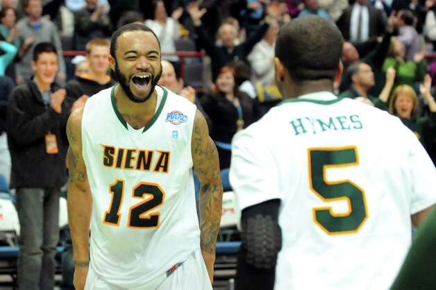 Siena's Rakeem Brookins, left, celebrates his last-second 3-point basket to win 57-54 over Canisius in their conference basketball game on Friday, Jan. 11, 2013, at Times Union Center in Albany, N.Y. (Cindy Schultz / Times Union) Photo: Cindy Schultz / 00020599C