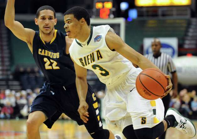 Siena's Ryan Oliver (3), right, drives past Canisius' Isaac Sosa (22) during their basketball game on Friday, Jan. 11, 2013, at Times Union Center in Albany, N.Y. (Cindy Schultz / Times Union) Photo: Cindy Schultz / 00020599C