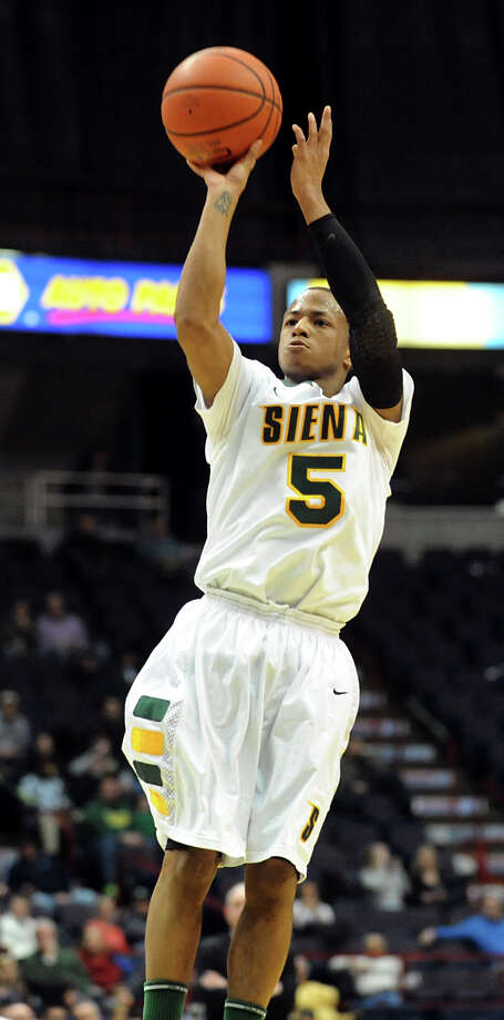 Siena's Evan Hymes (5) shoots for three points during their basketball game against Canisius on Friday, Jan. 11, 2013, at Times Union Center in Albany, N.Y. (Cindy Schultz / Times Union) Photo: Cindy Schultz / 00020599C