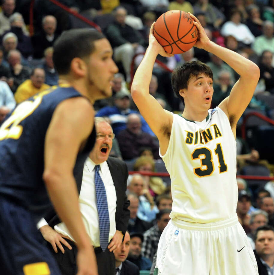 Siena's Brett Bisping (31), right, looks to pass during their basketball game against Canisius on Friday, Jan. 11, 2013, at Times Union Center in Albany, N.Y. (Cindy Schultz / Times Union) Photo: Cindy Schultz / 00020599C