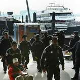 Paramedics wheel an injured ferry passenger away after the boat crashed on Wednesday in New York.  At least 57 people were injured, two critically, when a commuter ferry struck a dock in New York City's financial district, ripping open a right-side front corner.