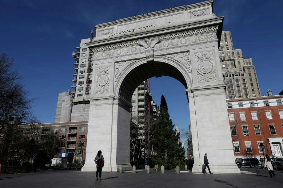Pedestrians pass the arch in Washington Square park Thursday, Jan. 10, 2013, in New York. A man accused of keeping bomb-making materials in his Greenwich Village apartment told acquaintances that he planned to blow up the Washington Square park arch police said Thursday. Photo: AP