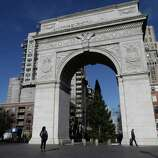 Pedestrians pass the arch in Washington Square park Thursday, Jan. 10, 2013, in New York. A man accused of keeping bomb-making materials in his Greenwich Village apartment told acquaintances that he planned to blow up the Washington Square park arch police said Thursday.