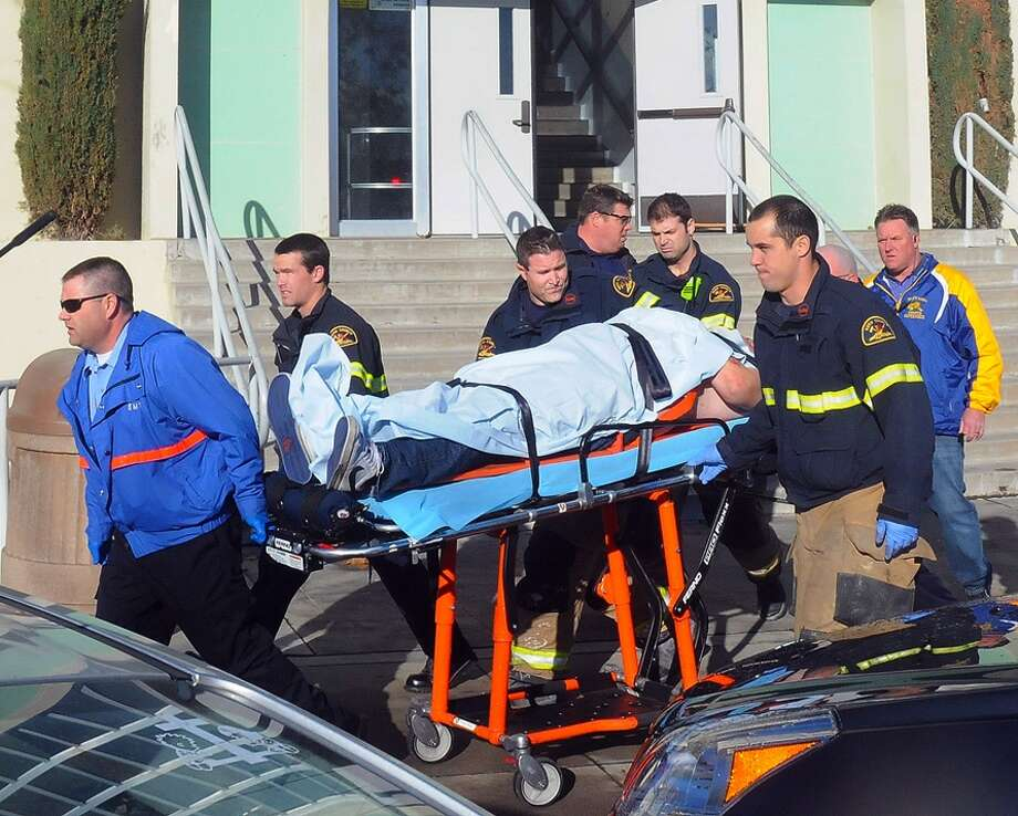 This image provided by the Taft Midway Driller/Doug Keeler shows paramedics transporting a student wounded during a shooting Thursday at San Joaquin Valley high school in Taft, Calif. Authorities said a student was shot and wounded and another student was taken into custody. Photo: AP
