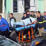 This image provided by the Taft Midway Driller/Doug Keeler shows paramedics transporting a student wounded during a shooting Thursday at San Joaquin Valley high school in Taft, Calif. Authorities said a student was shot and wounded and another student was taken into custody.