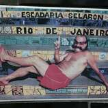 "An undated photo of Chilean artist Jorge Selaron decorates a tile that is part of a wall on a public staircase he decorated and titled the ""Selaron Stairway"" in Rio de Janeiro, Brazil, on Thursday. Selaron, an eccentric Chilean artist and longtime Rio resident who created a massive, colorful tile stairway in the bohemian Lapa district that's popular with tourists, was found dead on the stairway on Thursday. Authorities said he may have taken his own life by setting himself on fire on the very steps of his masterpiece."